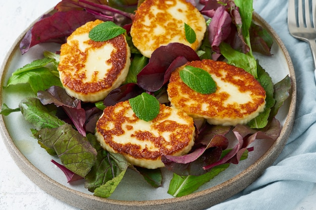 Cyprus roasted halloumi with salad mix, beet tops. lchf, pegan, fodmap, paleo, scd