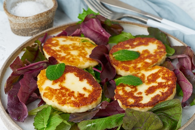 Cyprus roasted halloumi with salad mix, beet tops. lchf, pegan, fodmap, paleo