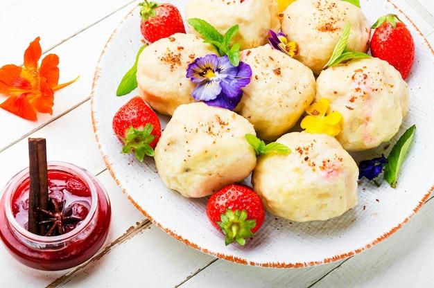 Czech dumplings varenyky with berries.dumplings with strawberries or knedlik.