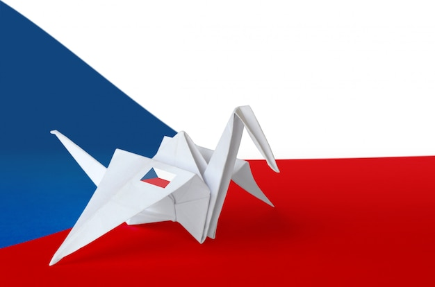 Czech flag depicted on paper origami crane wing. handmade arts concept background