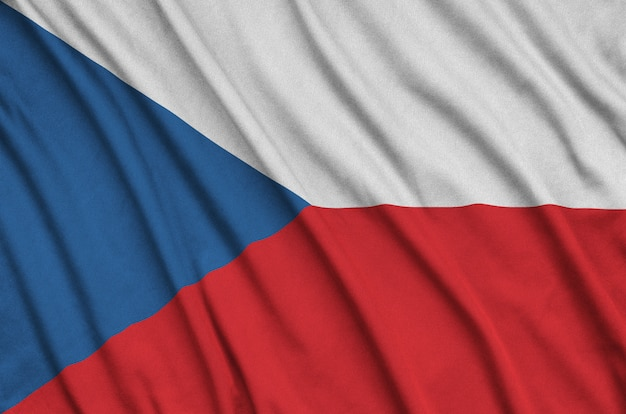 Czech flag is depicted on a sports cloth fabric with many folds.