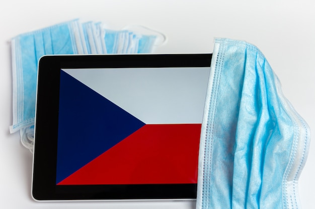 Czech republic flag covered by surgical protective mask for coronavirus covid-19 prevention