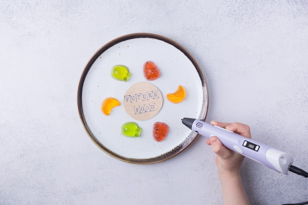 D 인쇄 식품 개념 d 펜 과일 현대 첨가제 기술 산업 혁명 고품질 사진