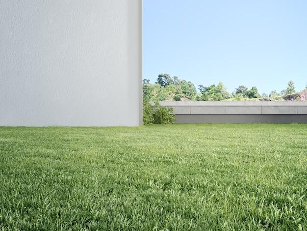푸른 하늘 배경으로 푸른 잔디 잔디밭에 빈 흰 벽의 d 렌더링
