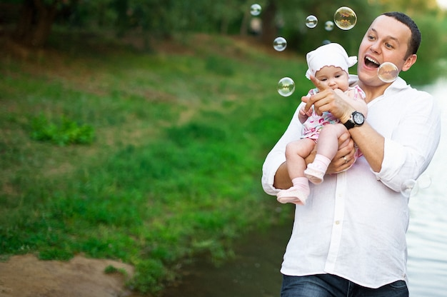Dad and the baby are having fun in the park