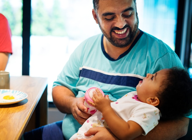 Dad bonding with baby daughter