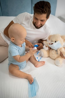 Dad and child playing with teddy bear
