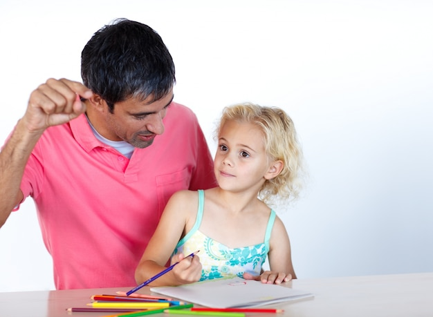 Dad and daughter doing homework together