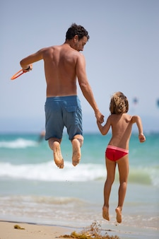 Dad and daughter happy together on the beach