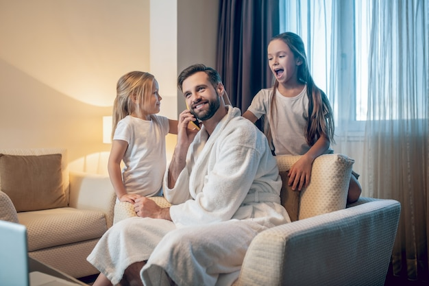 Dad and kids. young dad working from home and spending time with his daughters