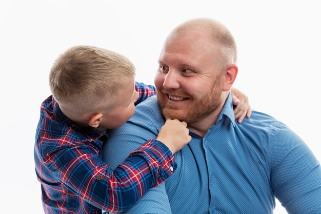Dad and little son are smiling and hugging. love and tenderness in a relationship. isolated.