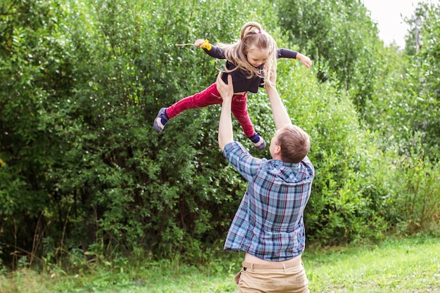 Dad throws the child up in the air, the game of dad and child
