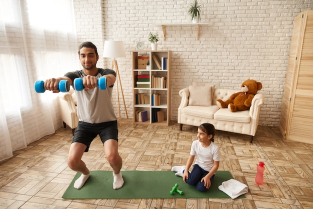 Dad with daughter are keeping healthy lifestyle