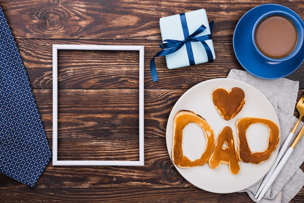 Dad word written in bread buns  and wooden board