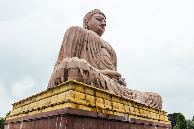 Daibutsu, the great buddha statue in meditation pose or dhyana mudra seated on a lotus in open air near mahabodhi temple at bodh gaya, bihar, india