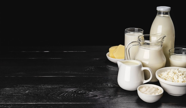 Dairy products on black wooden surface