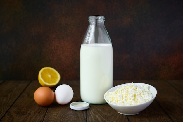Dairy products, cottage cheese and milk, chicken eggs and lemon
