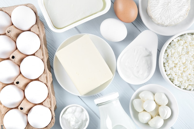 Dairy products and eggs on wooden table