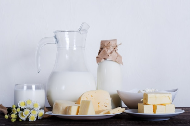 Dairy products. milk, cheese, butter and curd on old table