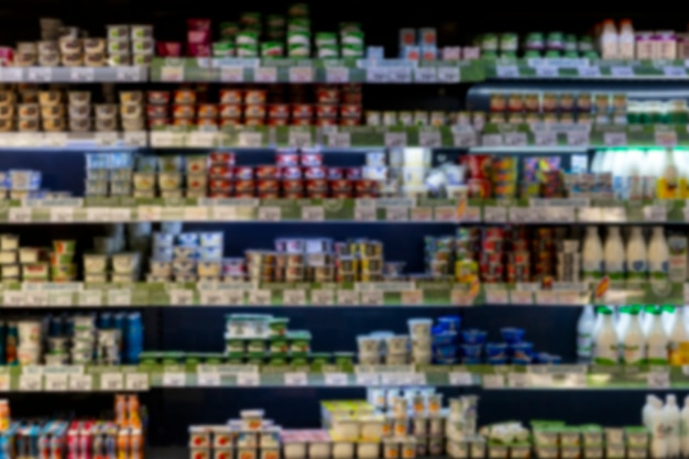 Dairy products on the shelves in the store. front view. blurred.