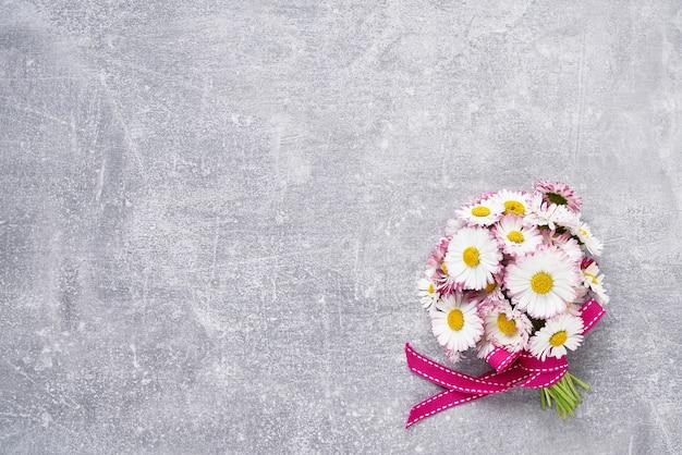 Daisy bouquet on gray concrete background
