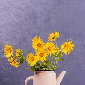 Daisy flowers in a watering can
