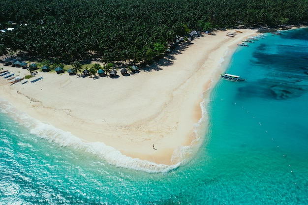 Daku island view from the sky. shot taken with drone above the beautiful island. concept about travel, nature, and marine landscapes