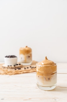Dalgona coffee. iced fluffy creamy whipped trend drink with coffee foam and milk. trendy drink during covid-19 city lock down and self quarantine, stay at home concept.