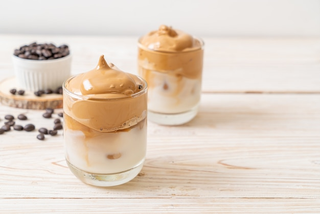 Dalgona coffee. iced fluffy creamy whipped trend drink with coffee foam and milk.