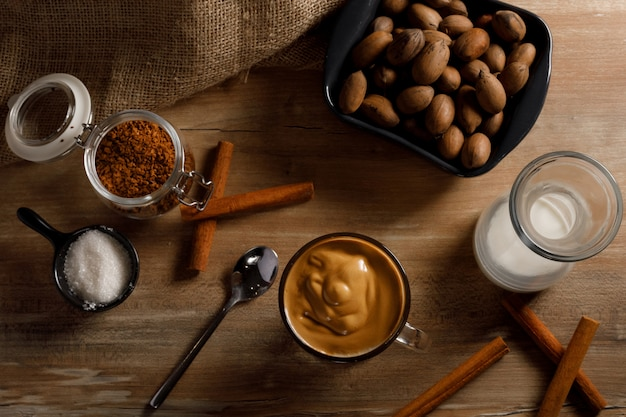 Dalgona coffee - the korean coffee drink on wooden background. instant coffee or espresso powder whipped with sugar and hot water. iced whipped dalgona coffee concept.top view.