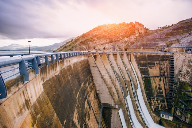 Dam in europe and italy. granite mountains ravine.