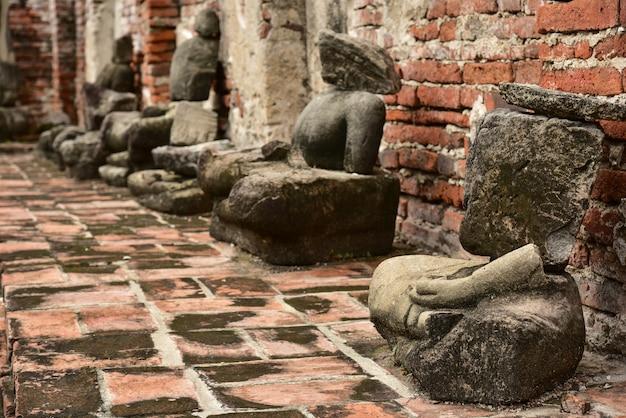 Damaged buddha statues at wat mahathat