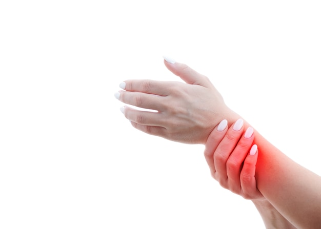 Damaged female hand hurts, sore spot is highlighted in red.