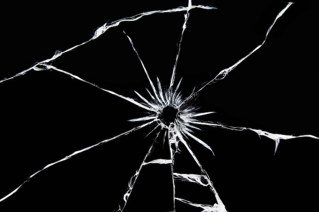 Damaged glass with cracks, cracks in the glass from the shot