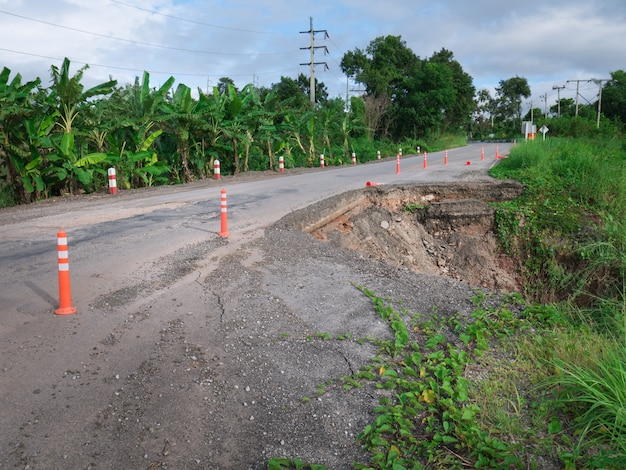 Damaged highway road in country side on the high