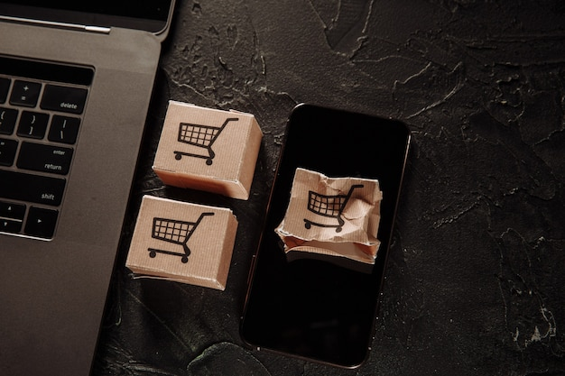 Damaged paper box on a screen of smartphone. online shopping and delivery concept