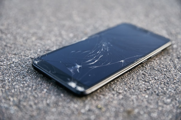 Damaged smartphone with broken touch screen