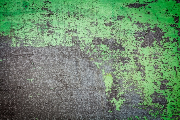 Damaged textured with green paint