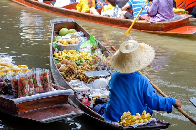 Damnoen saduak floating market, the famous attractions of ratchaburi province