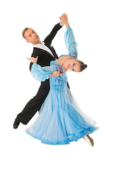 Dance ballroom couple in red dress dance pose isolated on black background