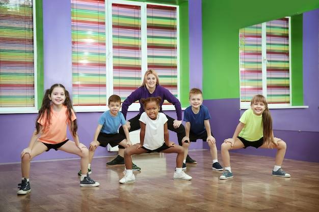 Dance teacher and children in choreography class