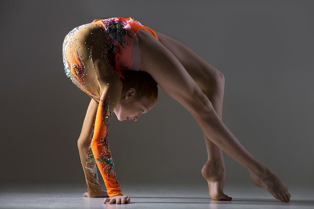 Dancer girl doing bridge exercise