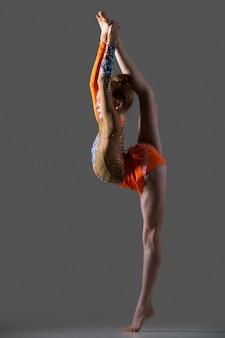 Dancer girl doing standing splits