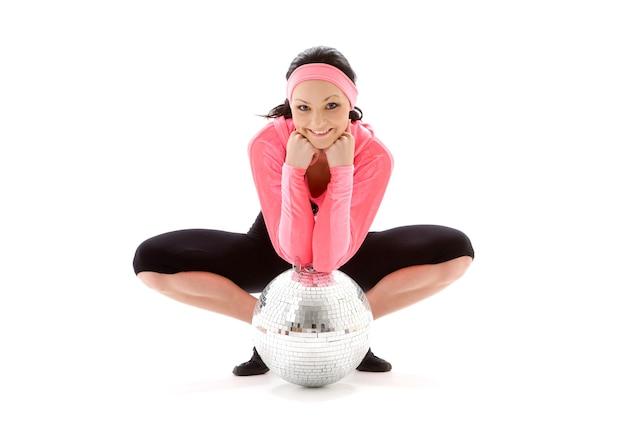Dancer girl with glitterball over white