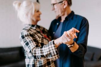 Dancing elderly couple in retirement home