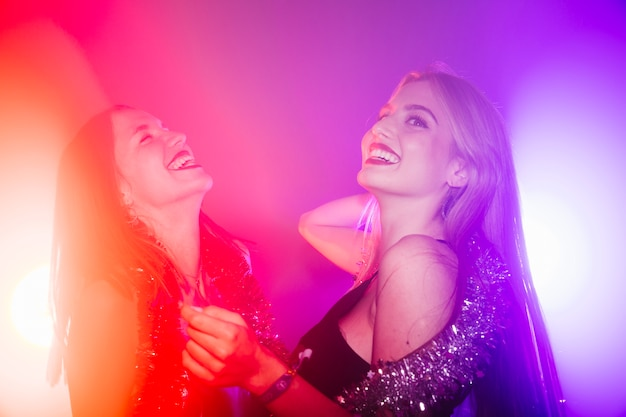 Dancing friends in nightclub