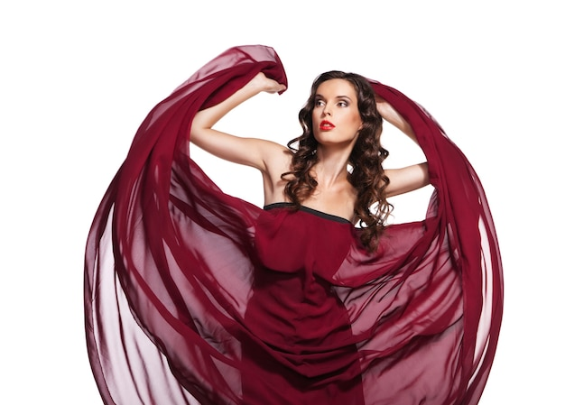 Танцующая женщина в красном платье, летящая на ветру