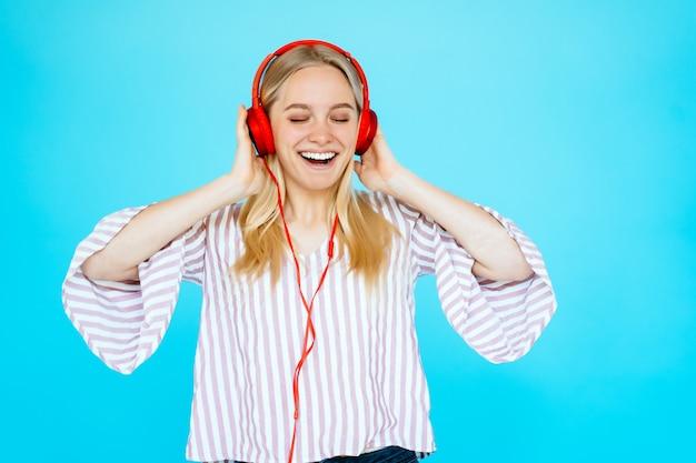 Dancing woman listens to music in headphones