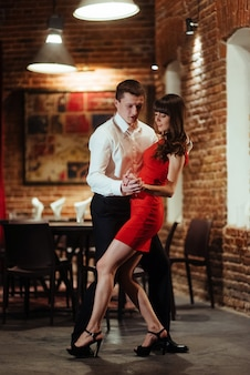 Dancing young couple on a white background. passionate salsa dan