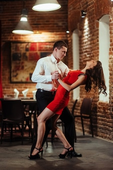 Dancing young couple on a white background. passionate salsa.